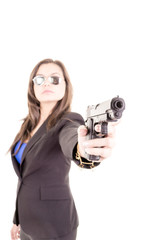 woman in suit and sunglasses holding a gun