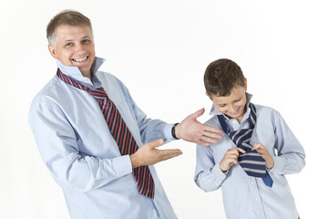 Father is laughing at his son's tie