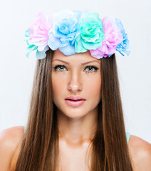 Beautiful woman with flower wreath