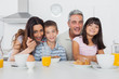 Cheerful family eating breakfast in kitchen together