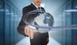 Businessman touching world on futuristic interface with swirling