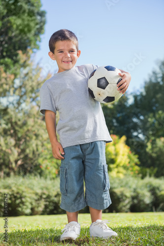 Young boy holding football