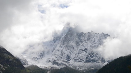 The petit Dru North face covered in clouds and frost time lapse