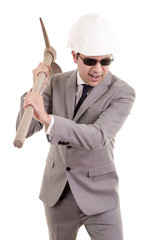 Man in suit displaying pick-axe