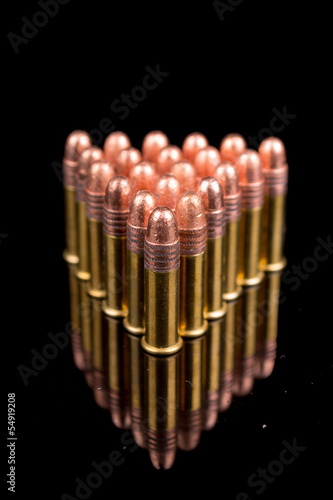 closeup shot, group of bullets on black background