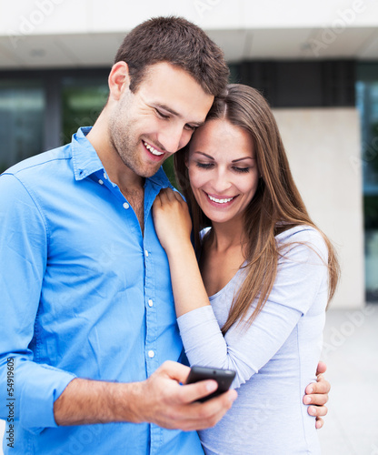 Couple with mobile phone