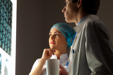 Two doctors examining x-ray results