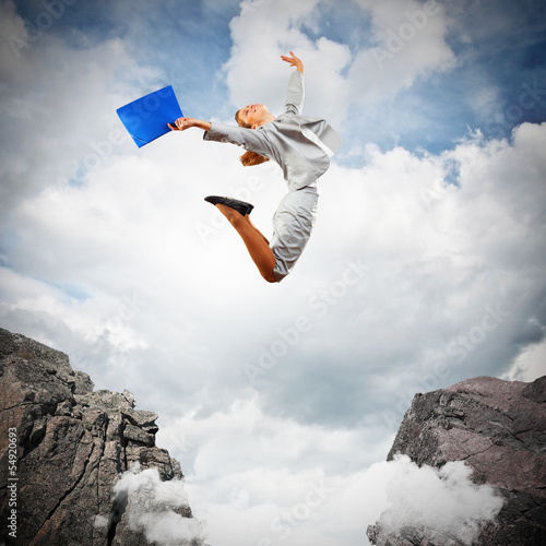 Young businesswoman jumping