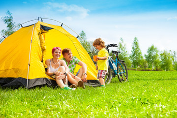 Yong couple with kid in a tent