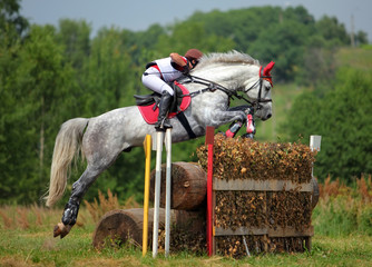 Three day event rider taking part in the cross country Phase