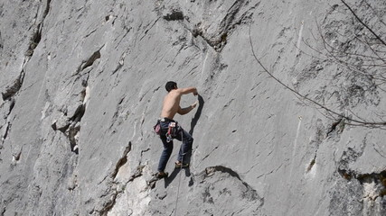 rock climber  struggles to find foothold