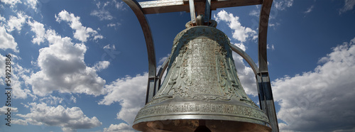 Orthodox bells closeup against the sky with clouds