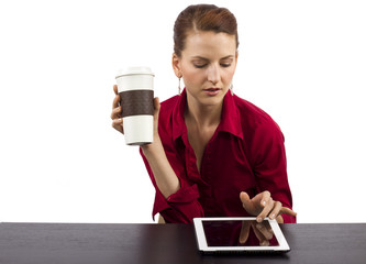 young woman with a tablet at the coffee shop