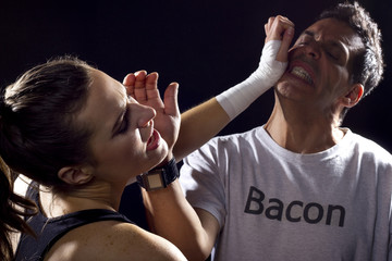 dieting concept. fighting man in bacon shirt