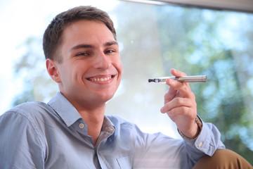 man smoking electronic cigarette (e-cigarette)
