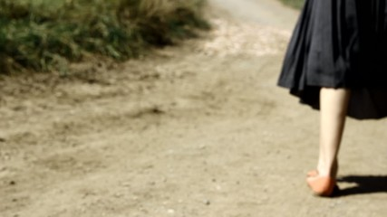 Poor woman on the dirty road, seeking for home.