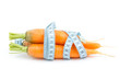 Healthy carrot with measure tape