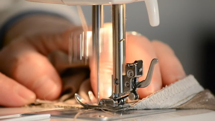 woman using sewing  machine close up
