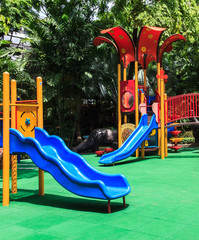 Blue Slides with Green Elastic Rubber Floor for Children in the