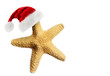 Leinwanddruck Bild - Santa Claus hat on starfish