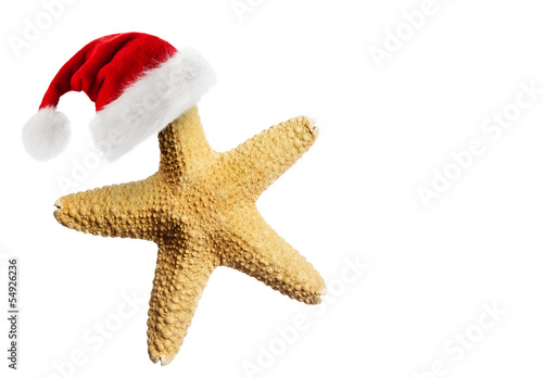 Leinwanddruck Bild Santa Claus hat on starfish
