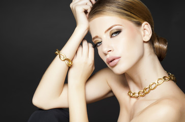 gold jewelry on beautiful woman model posing glamorous