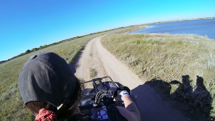 Female rider driving quad bike