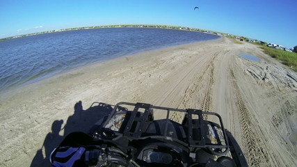 Riding quad bike through camping site POV