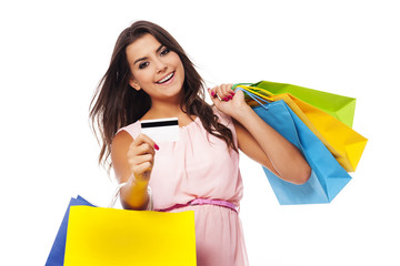 Gorgeous female with shopping bags and credit card