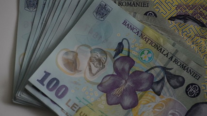 trowing stack of Romanian currency LEU