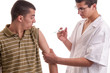 Young doctor give an injection to a pacient who is very afraid o