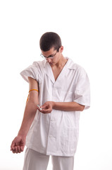 Closeup of young doctor injecting medicine in his arm