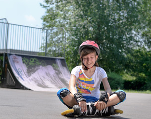 Beautiful young girl skater in rollerblades