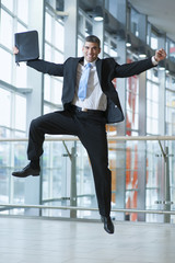 Happy Businessman leaps into the air