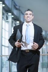Smiling businessman runs towards camera