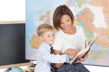 Teacher helping elementary student