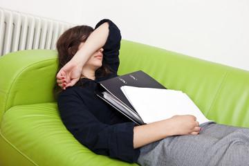 Businesswoman sleeping on a sofa