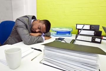 Indian businessman asleep at his desk