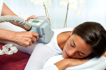 Woman having cellulite reduction massage.