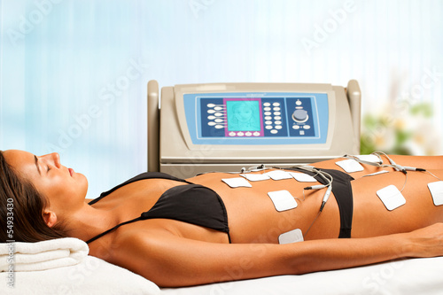 Woman having electrical lymphatic drainage.