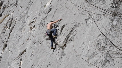 rock climber makes hard move then uses chalk