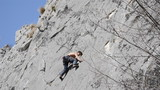 rock climber makes hard move and struggles to find foothold