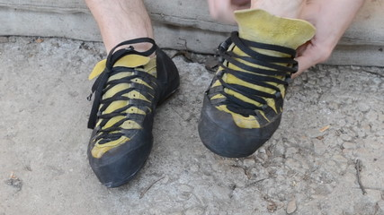 putting on climbing shoes and lacing