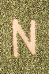 Letter N written with oregano