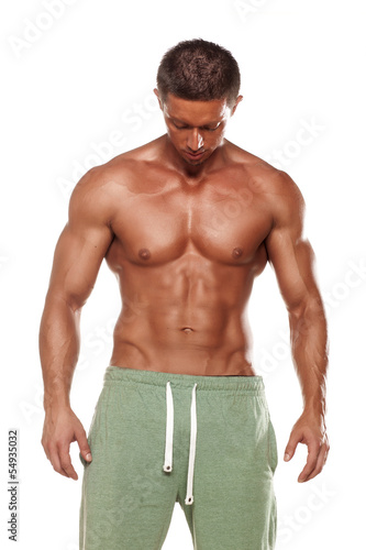 muscular handsome man posing on white background
