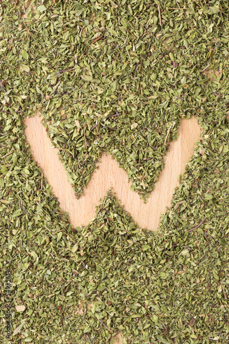 Letter W written with oregano