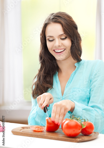 woman in the kitchen cutting tomatoes