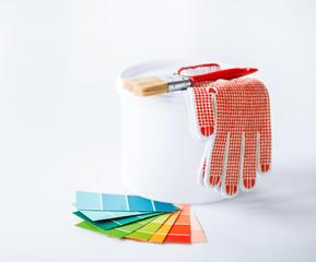 paintbrush, paint pot, gloves and pantone samplers