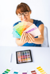 woman showing pantone color samples