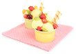 Delicious  ice cream with fruits and berries in bowl isolated